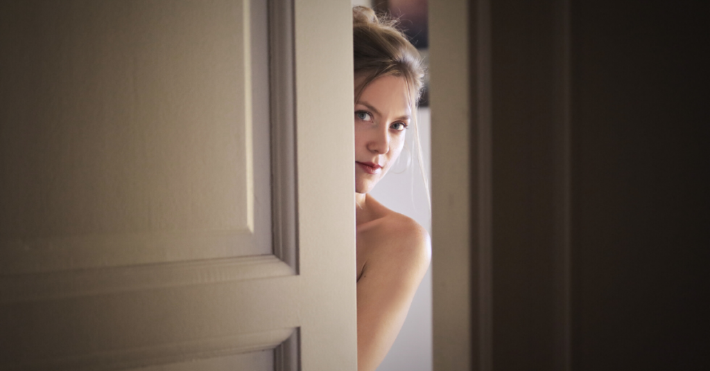 Woman peeking through the door